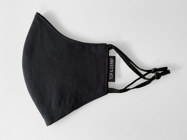 side view of kids sized black cotton face mask