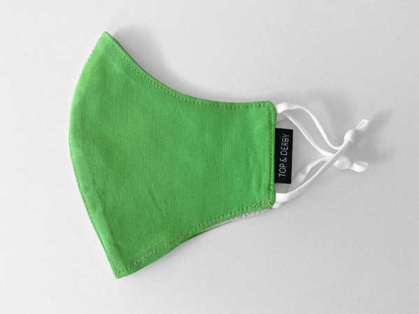 side view of green kids face mask
