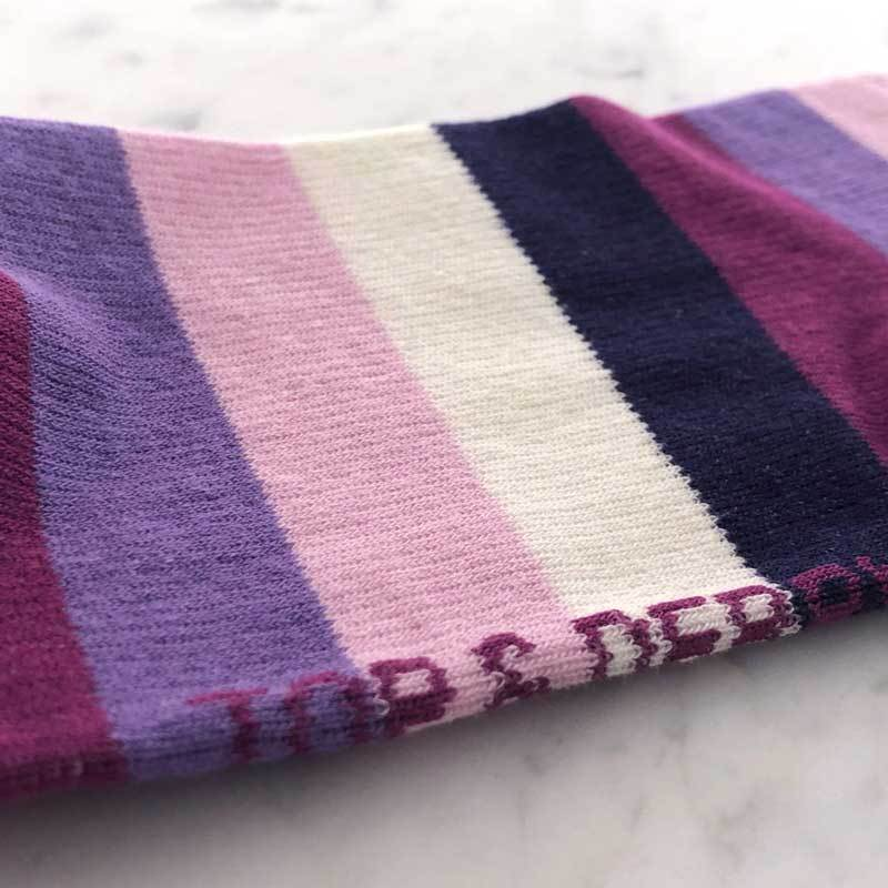 Close detail of purple and pink cotton medical support hose