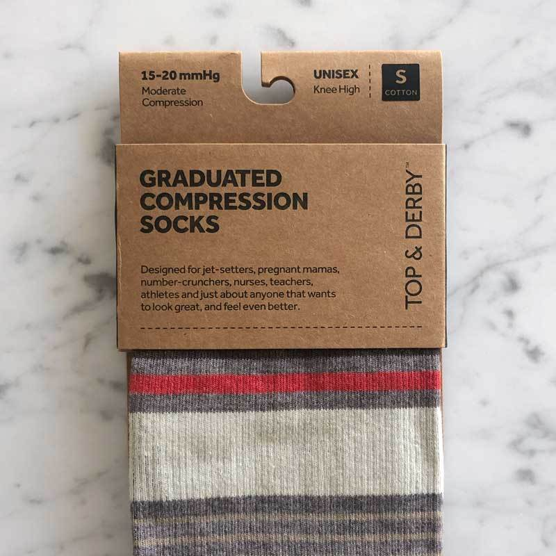 Stripe pattern prescription compression socks in brown, cream and red in packaging