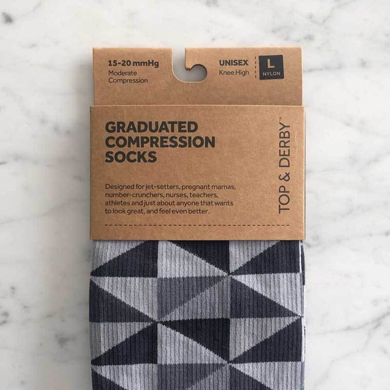 Triangle pattern medical compression stockings in black and grey in packaging