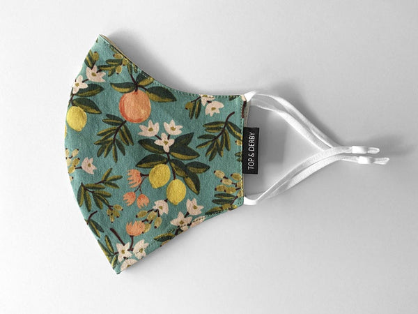 side view of teal floral patterned cotton face mask