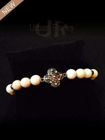 Bone Colored Beads with Hematite 4 Leaf Clover Bezel