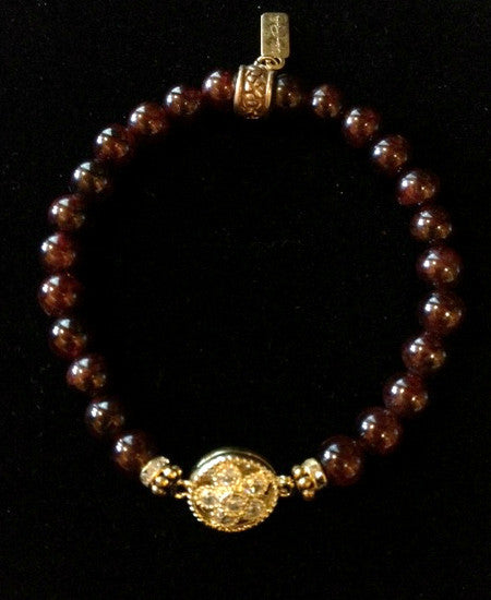 Garnet with Gold Crystal Flower Bezel