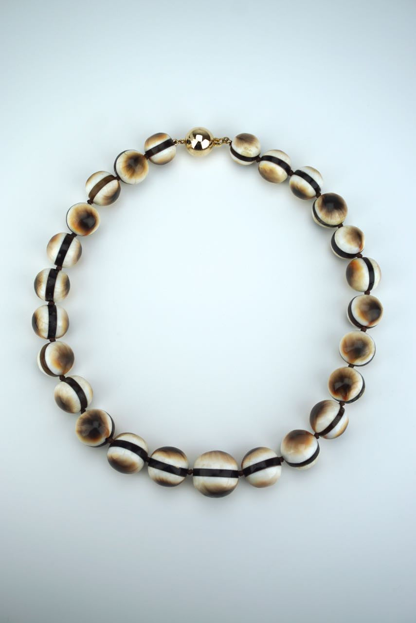 Operculum and tortoiseshell beads