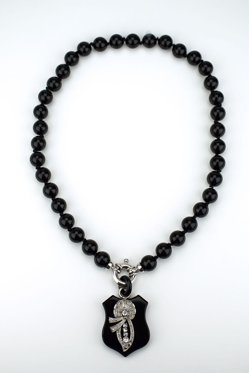 Diamond and onyx shield necklace