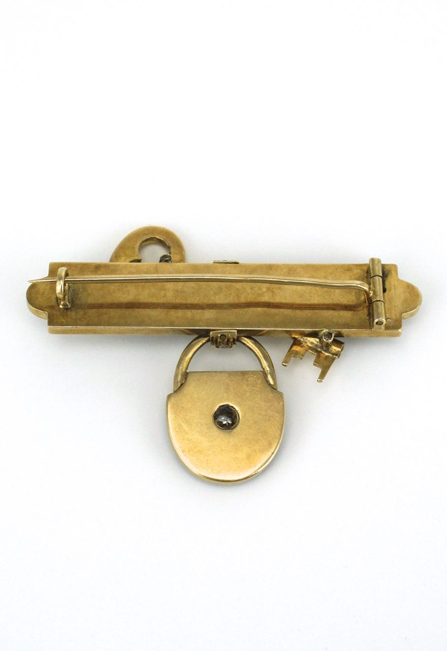 Antique gold diamond and black enamel key brooch
