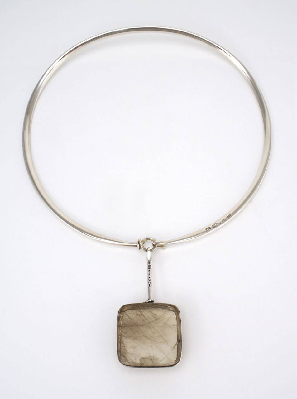 Georg Jensen silver neck ring and rutilated quartz pendant design 410 Torun