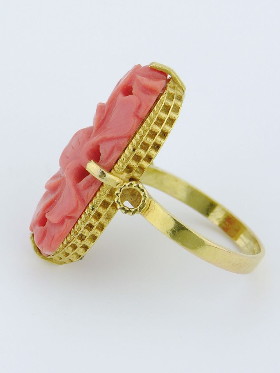 Gold and carved coral ring