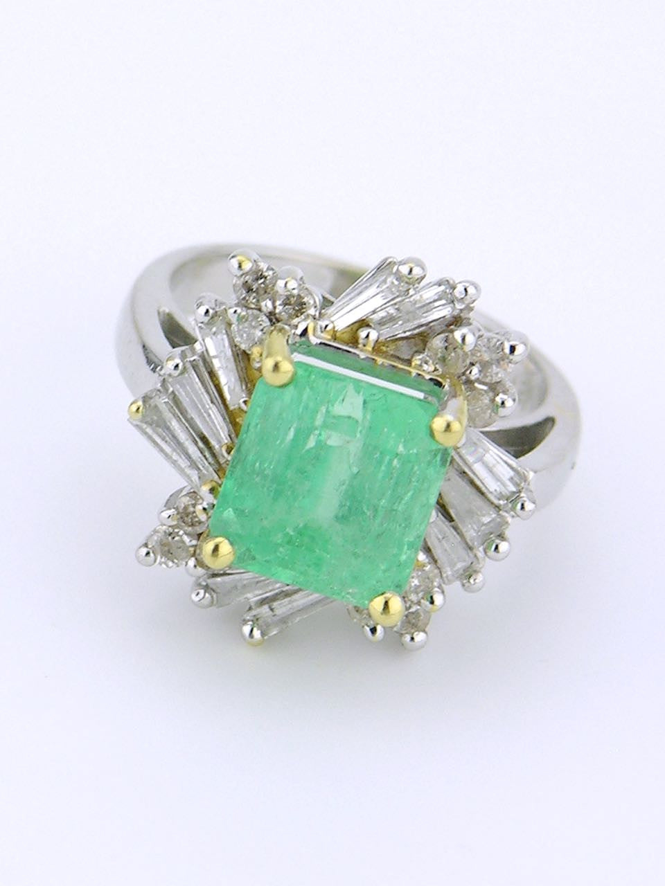 White gold emerald and diamond cluster ring