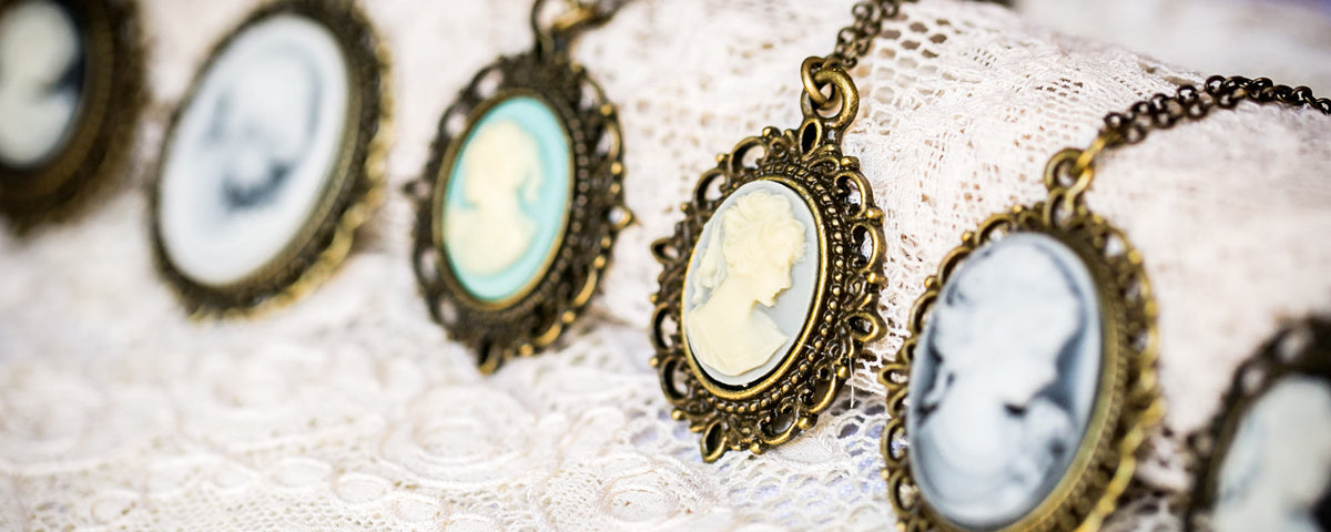 vintage resin cameo necklaces on lace background