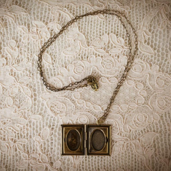 literature book locket lying open on lace