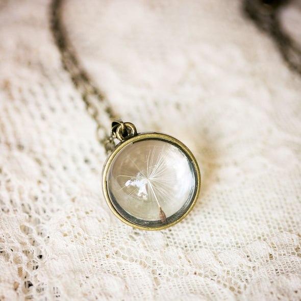 Brass dandelion seed necklace with single seed on lace