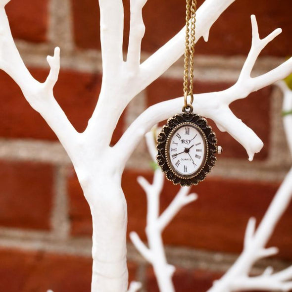 cameo pocket watch vintage necklace hanging on tree, watch view