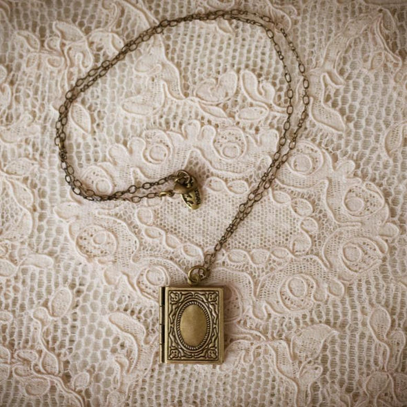 literature book locket bare on lace