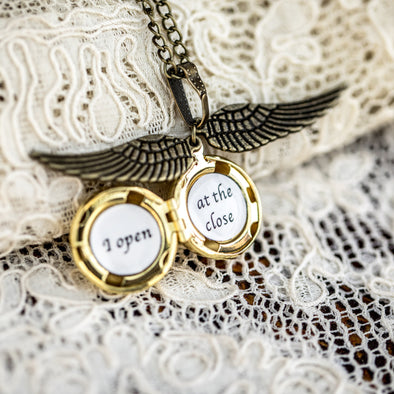I open at the close golden snitch necklace