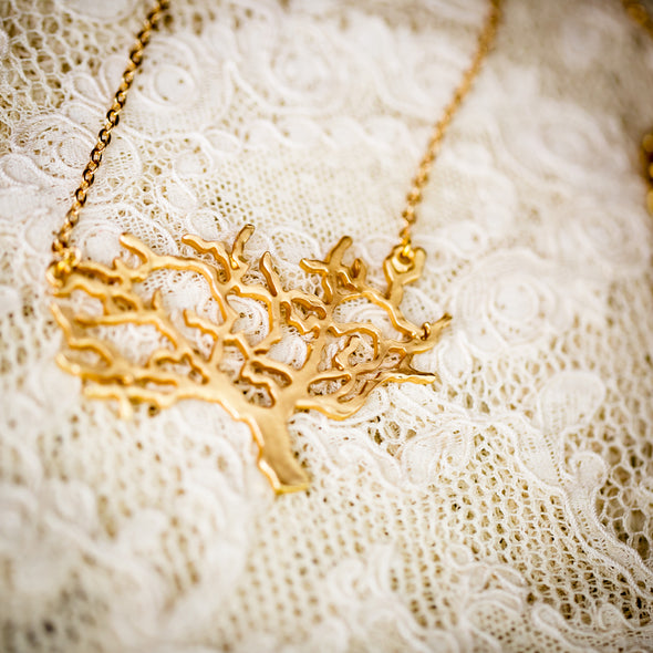 The Kamali large gold necklace large on lace close-up