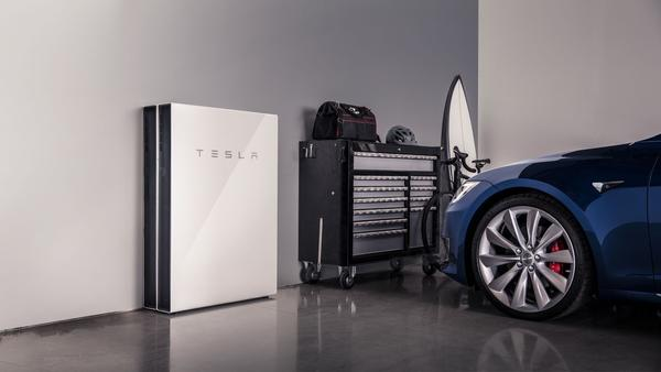 Blue Tesla Model S and Tesla Powerwall
