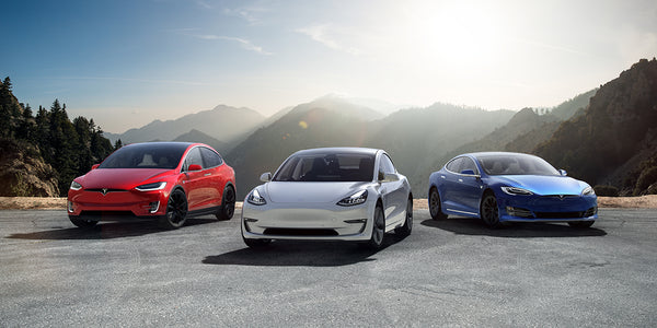 Red, white, and blue Tesla vehicle lineup