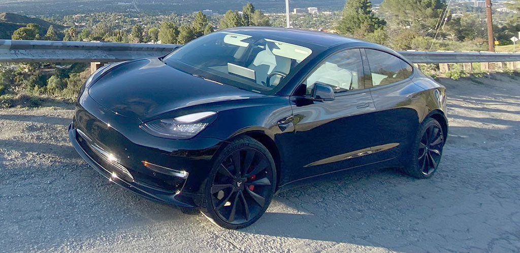Black Tesla Model Y in the wild.