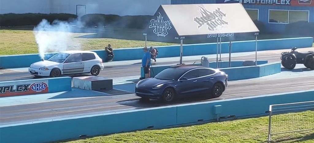 Tesla Model 3 AWD vs. Honda Civic drag race