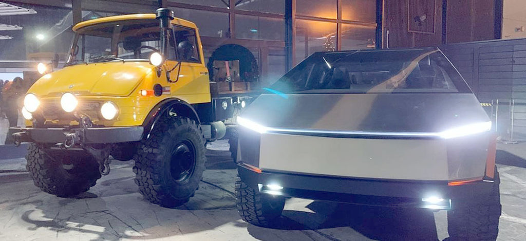 Cybertruck side-by-side with a Mercedes Unimog at the Tesla Design Center.