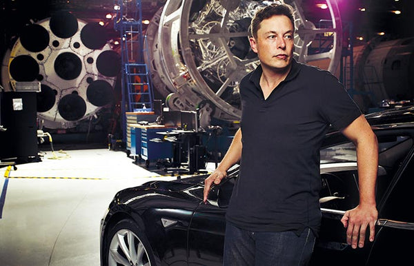 above elon musk leans on his tesla at the spacex offices image jebiga