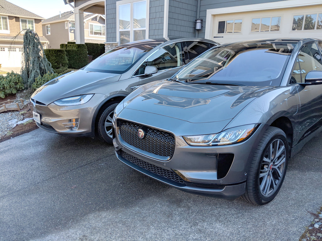 Jaguar I-Pace and Tesla Model X parked side-by-side - front view