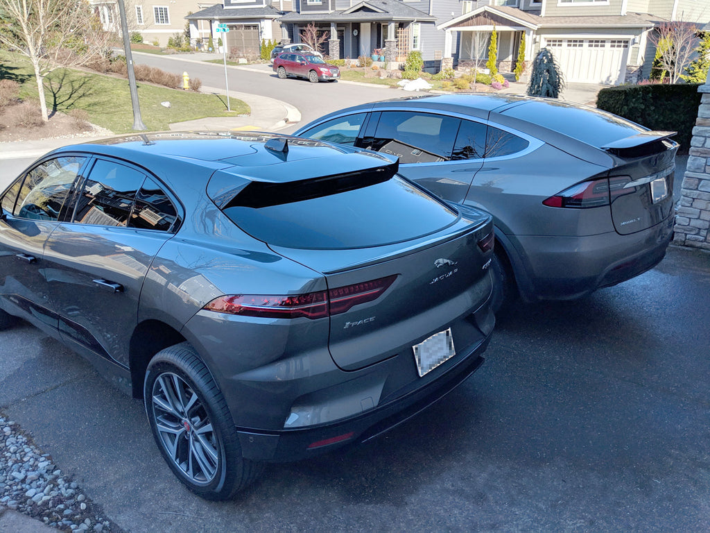Jaguar I-Pace and Tesla Model X parked side-by-side - rear view