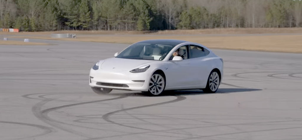 Tesla Model 3 Standard Range Plus drifting on the race track.