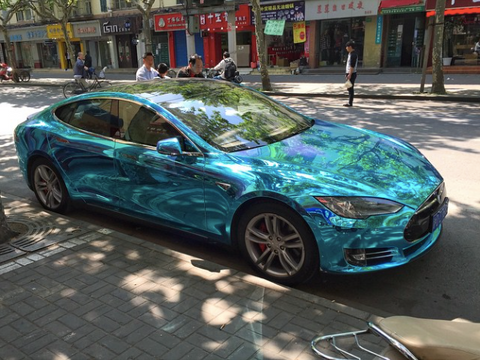 Tesla Model S wrapped in crystal blue ocean water