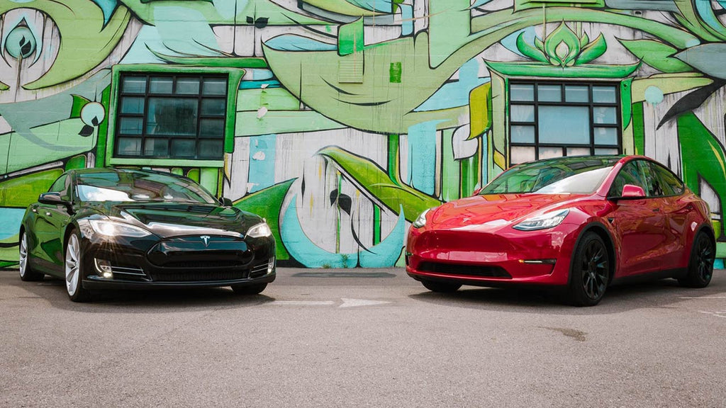 Tesla Model S and Model 3 in front of graffiti wall.