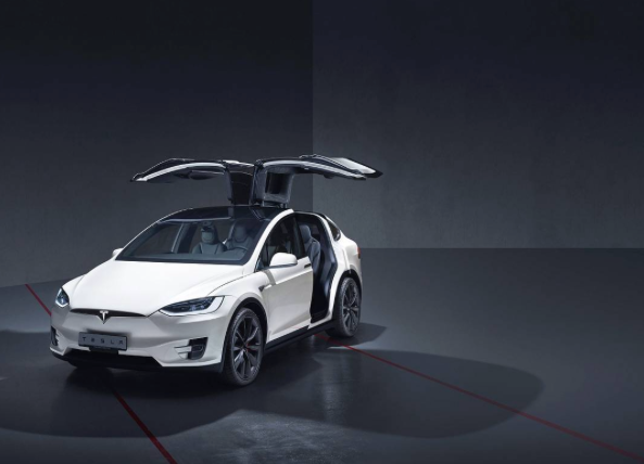Wall street journal led by tesla the car of the future for Wall street motor cars