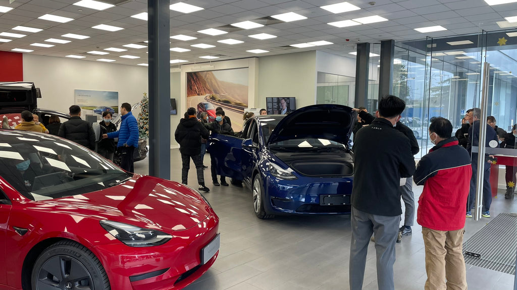 People flock to a Tesla showroom  in China to check out Tesla Model Y.