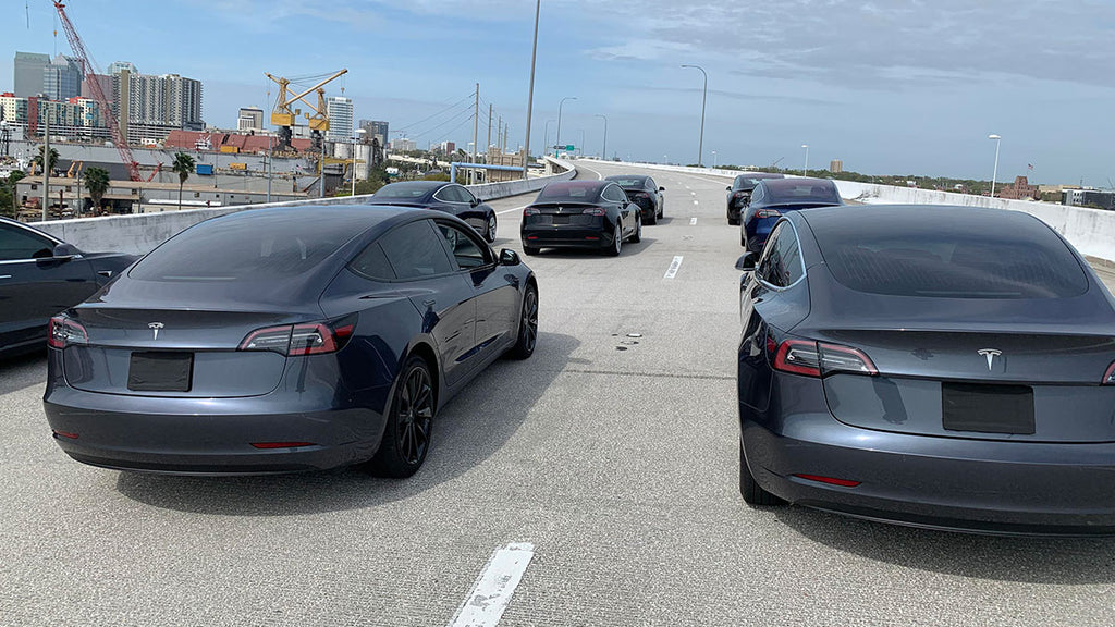 9 Tesla Model 3 volunteer owners with their cars on the Tampa Expressway, FL for the filming of the documentary.