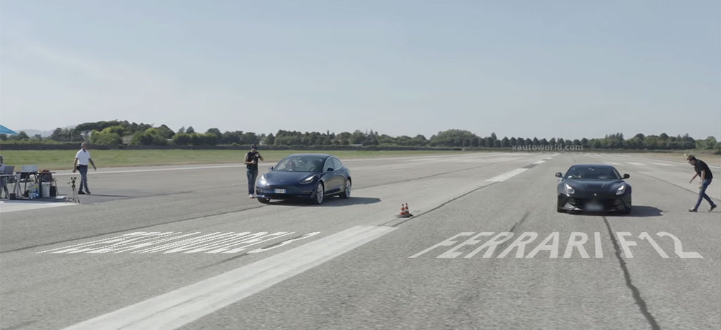 Tesla Model 3 vs. Ferrari F12 ready for the race at the drag strip.