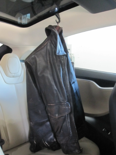 Tesla Model S coat hook in use