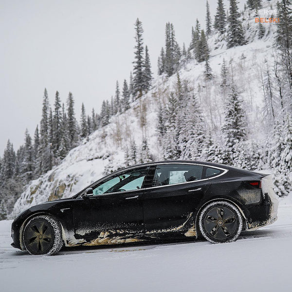 Black Tesla Model 3 in Snow - Side View