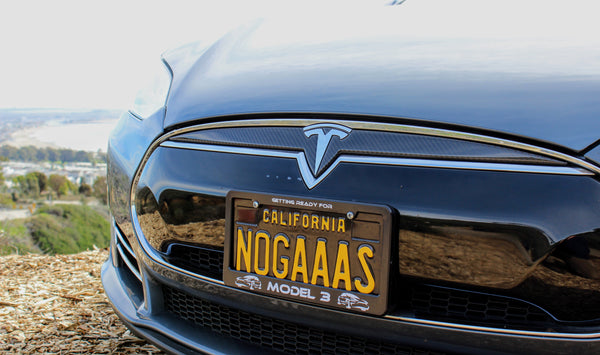 Check Out These Clever Personalized Tesla License Plates