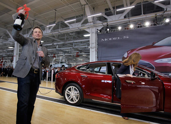 Tesla shares dip as automaker racks up record loss