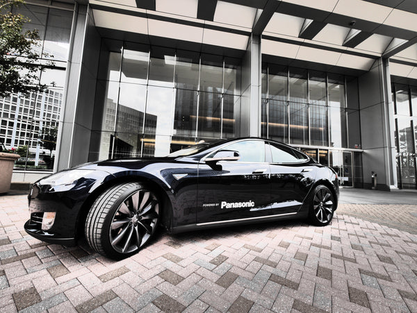Black Panasonic Tesla Model S company car