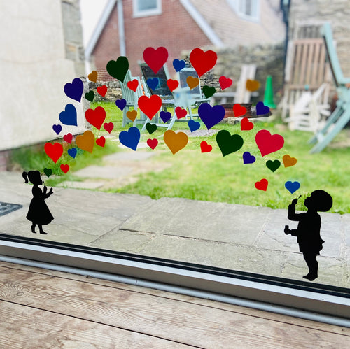 Girl and Boy Blowing Rainbow Heart Stickers - Create Window Wall Glass Display 7 Colours