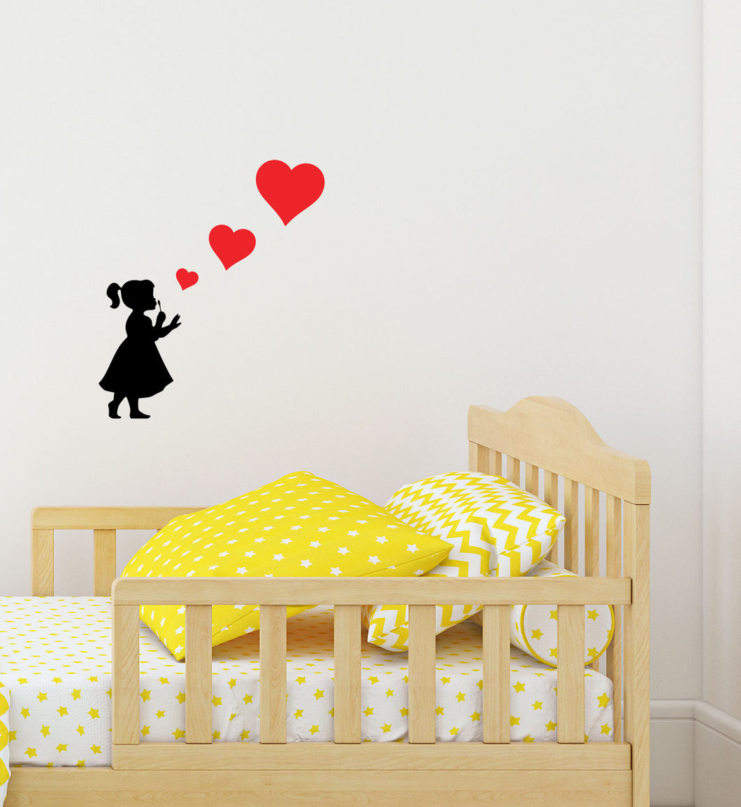 Girl Blowing Three Heart Stickers - Children's Wall Art