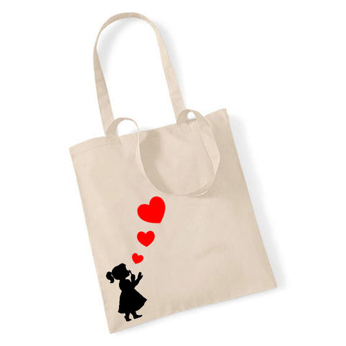 Girl Blowing Three Hearts - Tote Bag
