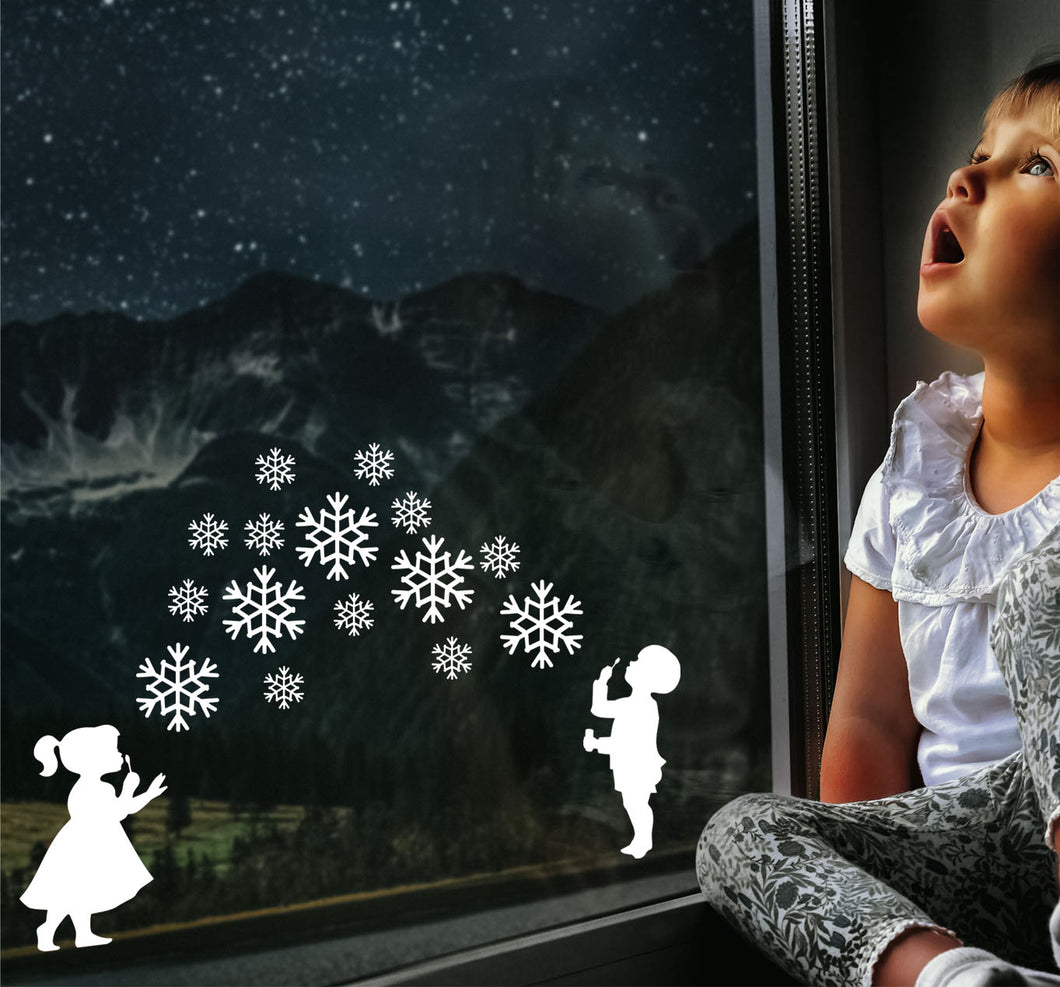 Boy And Girl Blowing Snowflakes - Christmas Wall / Window Sticker