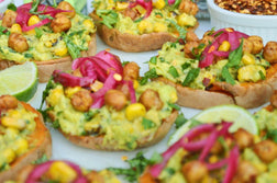 Spicy Roasted Corn Guacamole Sweet Potato Toasts