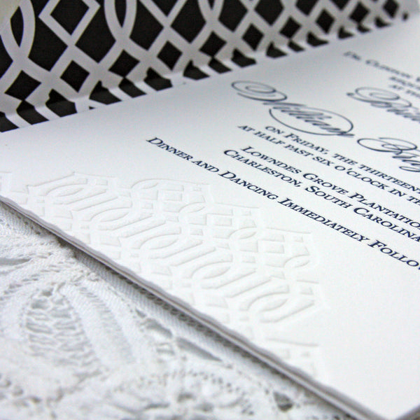 Wedding Invitation with trellis details in a blind impression on the invitation and navy envelope liner