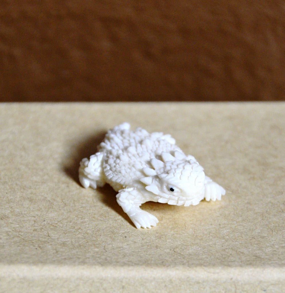 Tiny but mighty, fearless but sweet. This says it all of our hand crafted Horned Lizard carving.