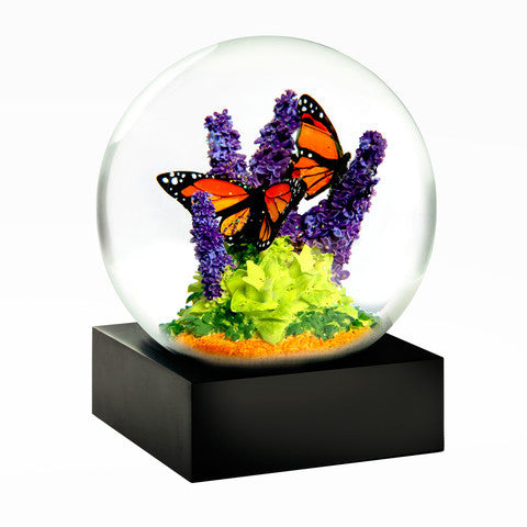 monarch butterlies amid purple flowes and greenery