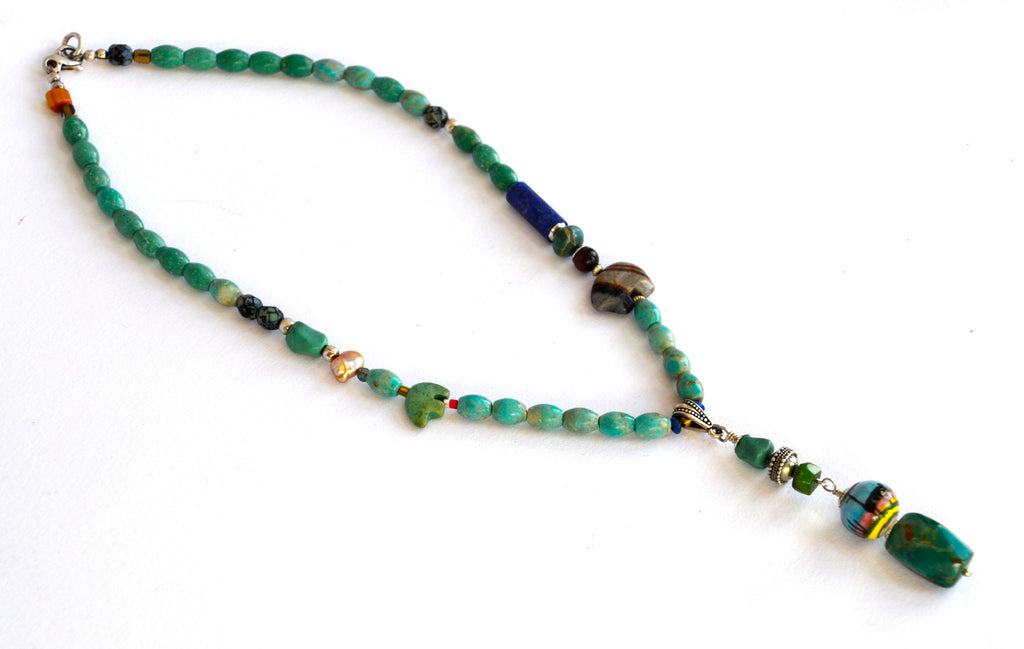 For the lover of individuality, this many hued rustic turquoise necklace will be the one you reach for.
